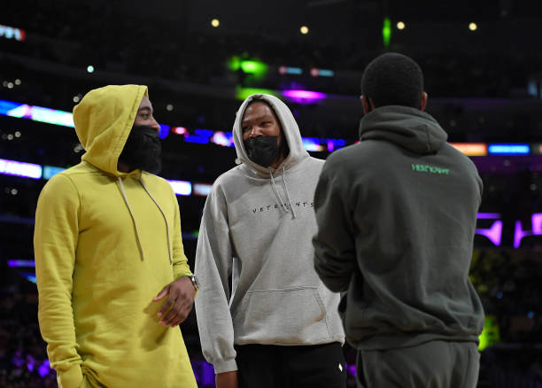 Kevin Durant Kyrie Irving and James Harden of the Brooklyn Nets get together during a time out in the first half of a pre-season game against Los...