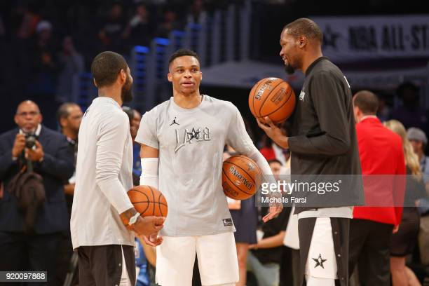 Kevin Durant Kyrie Irving and Russell Westbrook of Team LeBron talk on the court before the NBA AllStar Game as a part of 2018 NBA AllStar Weekend at...