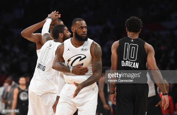 Kevin Durant Kyrie Irving LeBron James of Team LeBron celebrate as DeMar Derozan of Team Stephen looks on during the NBA AllStar Game 2018 at Staples...