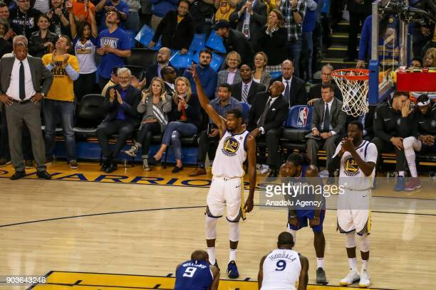 Kevin Durant of Golden State Warriors gestures as fans cheer celebrating his 20000th career point during the NBA basketball game between LA Clippers...