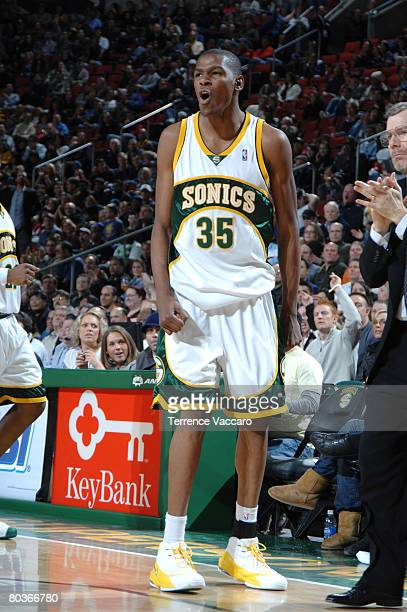 Kevin Durant of Seattle SuperSonics cheers on his fellow Sonics in the game against the Portland Trail Blazers on March 24 2008 at the Key Arena in...