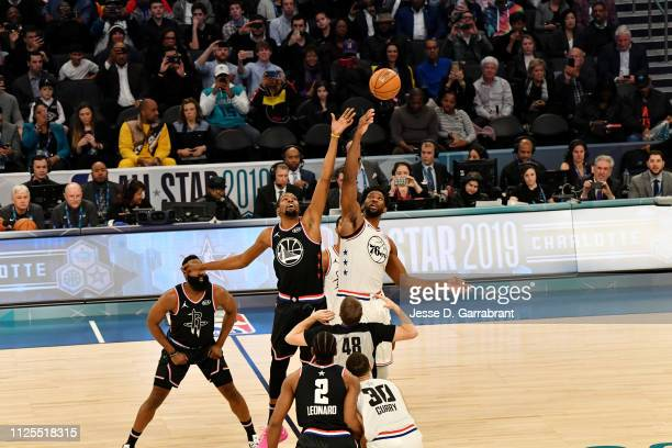 Kevin Durant of Team LeBron and Joel Embiid of Team Giannis jump for tip off during the 2019 NBA All Star Game on February 17 2019 at Spectrum Center...