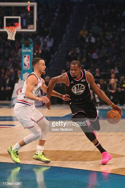 Kevin Durant of Team LeBron handles the ball against Stephen Curry of Team Giannis during the 2019 NBA AllStar Game on February 17 2019 at the...