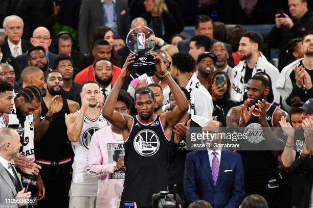 Kevin Durant of Team LeBron holds the MVP trophy after the 2019 NBA All Star Game on February 17 2019 at Spectrum Center in Charlotte North Carolina...