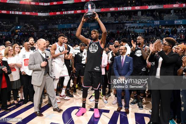 Kevin Durant of Team LeBron holds up the MVP trophy after the 2019 NBA AllStar Game on February 17 2019 at the Spectrum Center in Charlotte North...