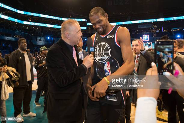 Kevin Durant of Team LeBron talks to the media on the court with the All Star Game MVP Trophy after the 2019 NBA All Star Game on February 17 2019 at...
