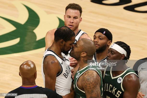 Kevin Durant of the Brooklyn Nets and P.J. Tucker of the Milwaukee Bucks exchange words during the second half of Game Three of the Eastern...