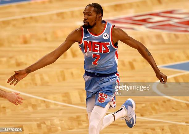 Kevin Durant of the Brooklyn Nets celebrates his shot in the first quarter against the San Antonio Spurs at Barclays Center on May 12, 2021 in the...
