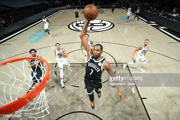 Kevin Durant of the Brooklyn Nets dunks the ball during the game against the Golden State Warriors on December 22, 2020 at Barclays Center in...