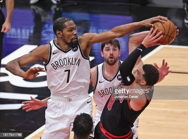 Kevin Durant of the Brooklyn Nets fouls Zach LaVine of the Chicago Bulls as he blocks his shot at the United Center on May 11, 2021 in Chicago,...