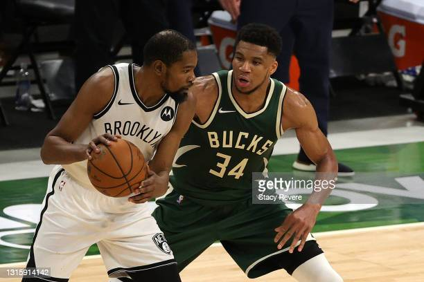 Kevin Durant of the Brooklyn Nets is defended by Giannis Antetokounmpo of the Milwaukee Bucks during the second half of a game at Fiserv Forum on May...