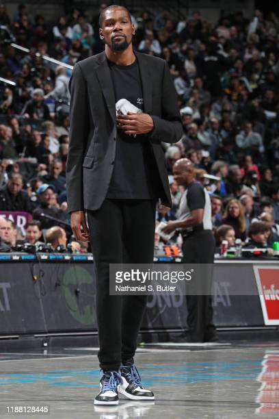 Kevin Durant of the Brooklyn Nets looks on during a game against the Denver Nuggets on December 8 2019 at Barclays Center in Brooklyn New York NOTE...