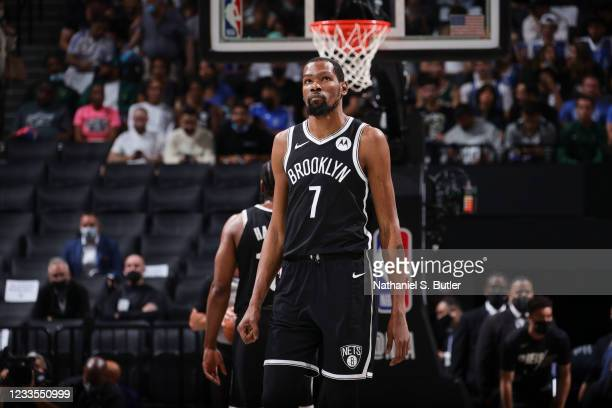 Kevin Durant of the Brooklyn Nets looks on during the game against the Milwaukee Bucks during Round 2, Game 7 of the 2021 NBA Playoffs on June 19,...