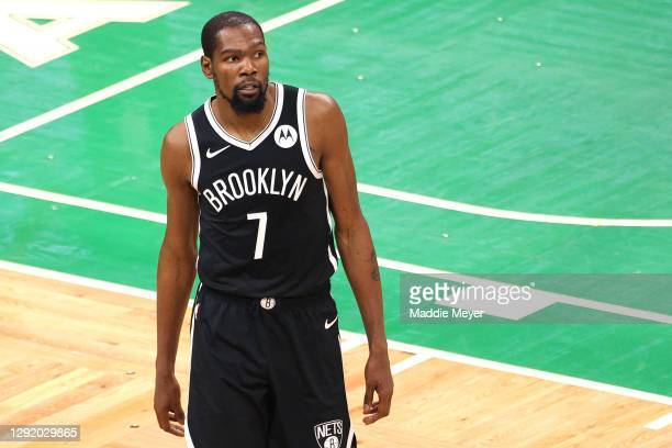 Kevin Durant of the Brooklyn Nets looks on during the preseason game between the Nets and the Boston Celtics at TD Garden on December 18, 2020 in...