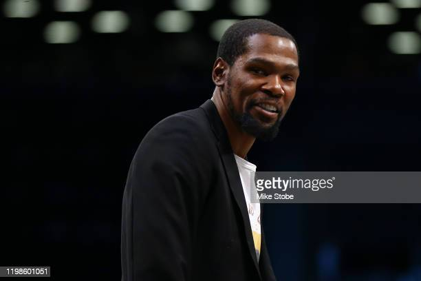 Kevin Durant of the Brooklyn Nets looks on from the bench during the game Phoenix Suns at Barclays Center on February 03, 2020 in New York...