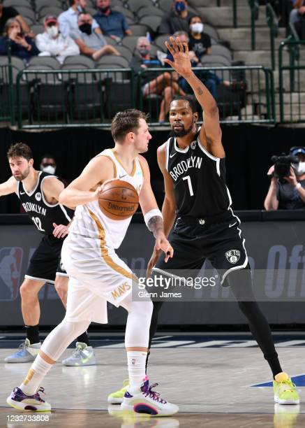Kevin Durant of the Brooklyn Nets plays defense on Luka Doncic of the Dallas Mavericks during the game on May 6, 2021 at the American Airlines Center...