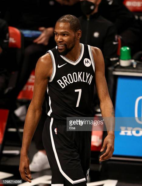 Kevin Durant of the Brooklyn Nets reacts in the second half against the Miami Heat at Barclays Center on January 23, 2021 in New York City.NOTE TO...