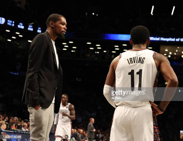 Kevin Durant of the Brooklyn Nets talks to Kyrie Irving of the Brooklyn Nets during their game against the Milwaukee Bucksat Barclays Center on...