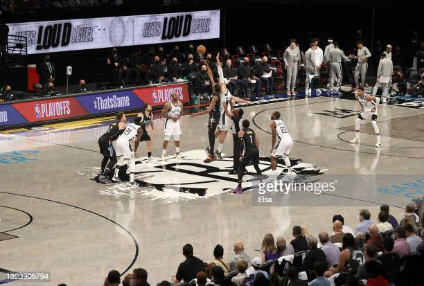 Kevin Durant of the Brooklyn Nets wins the opening tipoff over Brook Lopez of the Milwaukee Bucks to start game 5 of the Eastern Conference second...