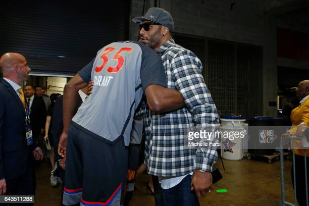 Kevin Durant of the Eastern Conference AllStar Team talks to Former NBA player Kenyon Martin before the NBA AllStar Game as part of the 2017 NBA All...
