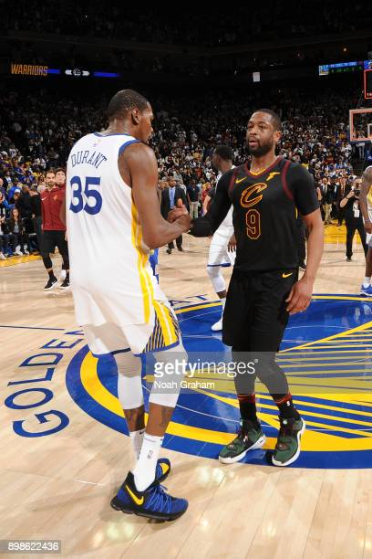 Kevin Durant of the Golden State Warriors and Dwyane Wade of the Cleveland Cavaliers share a handshake after the game on December 25 2017 at ORACLE...
