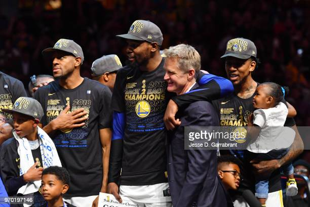 Kevin Durant of the Golden State Warriors and Head Coach Steve Kerr of the Golden State Warriors look on after defeating the Cleveland Cavaliers in...