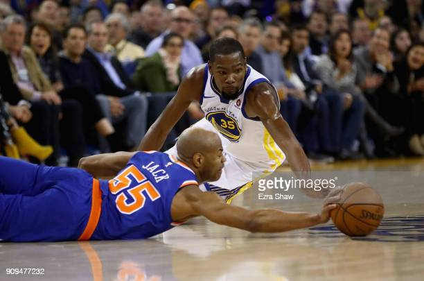 Kevin Durant of the Golden State Warriors and Jarrett Jack of the New York Knicks go for the ball at ORACLE Arena on January 23 2018 in Oakland...