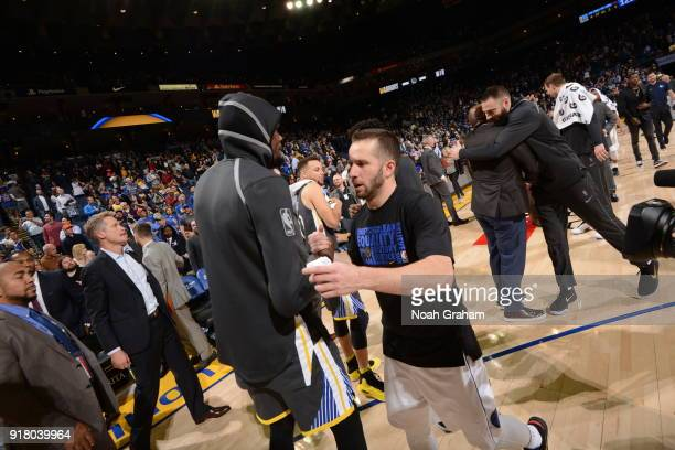 Kevin Durant of the Golden State Warriors and JJ Barea of the Dallas Mavericks after the game on February 8 2018 at ORACLE Arena in Oakland...