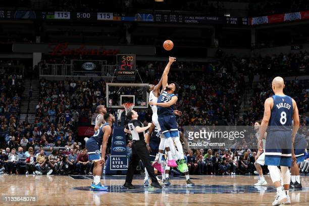 Kevin Durant of the Golden State Warriors and Karl-Anthony Towns of the Minnesota Timberwolves jump for tip-off at the start of overtime on March 29,...