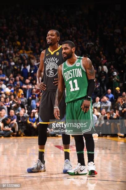 Kevin Durant of the Golden State Warriors and Kyrie Irving of the Boston Celtics during the game on January 27 2018 at ORACLE Arena in Oakland...