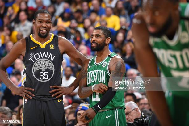 Kevin Durant of the Golden State Warriors and Kyrie Irving of the Boston Celtics look on during the game between the two teams on January 27 2018 at...
