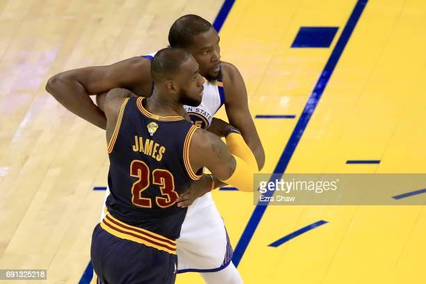 Kevin Durant of the Golden State Warriors and LeBron James of the Cleveland Cavaliers tangle in Game 1 of the 2017 NBA Finals at ORACLE Arena on June...