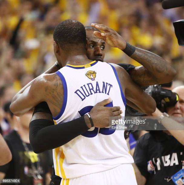 Kevin Durant of the Golden State Warriors and LeBron James of the Cleveland Cavaliers shake hands after Game 5 of the 2017 NBA Finals in which the...