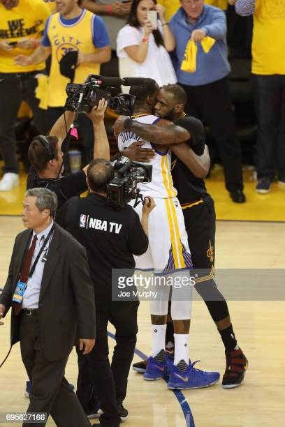 Kevin Durant of the Golden State Warriors and LeBron James of the Cleveland Cavaliers hug after Game Five of the 2017 NBA Finals on June 12 2017 at...