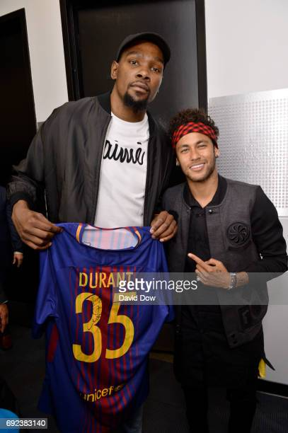 Kevin Durant of the Golden State Warriors and Neymar Jr of FC Barcelona poses for a photo after Game Two of the 2017 NBA Finals on June 4 2017 at...
