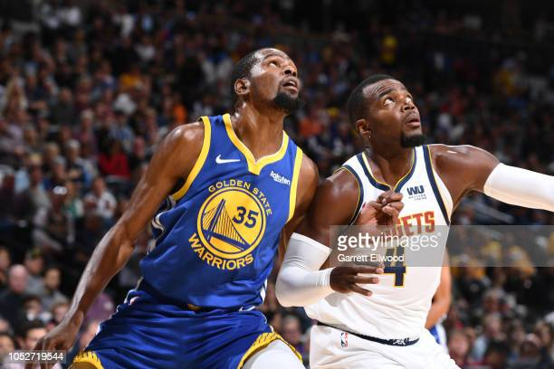 Kevin Durant of the Golden State Warriors and Paul Millsap of the Denver Nuggets wait for a rebound during the game on October 21 2018 at the Pepsi...