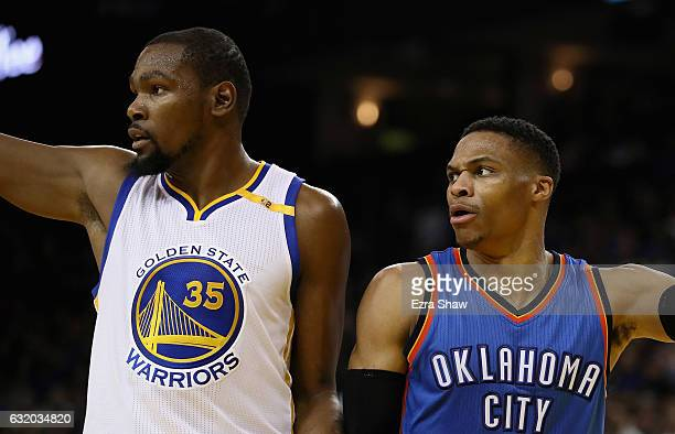 Kevin Durant of the Golden State Warriors and Russell Westbrook of the Oklahoma City Thunder point in different directions after the ball went out of...
