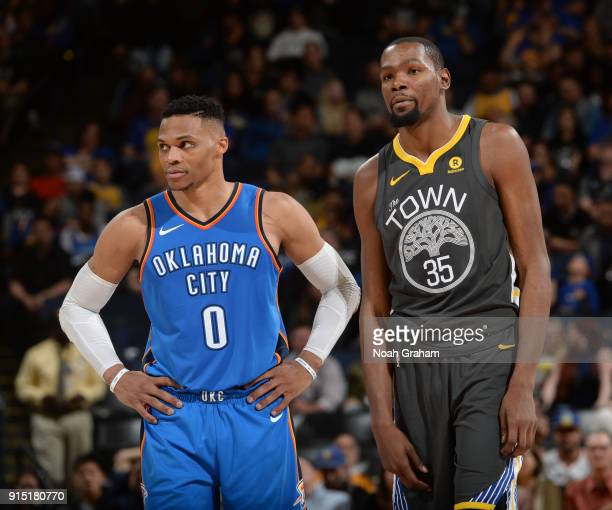 Kevin Durant of the Golden State Warriors and Russell Westbrook of the Oklahoma City Thunder look on during the game on February 6 2018 at ORACLE...