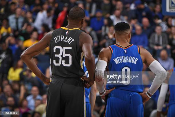 Kevin Durant of the Golden State Warriors and Russell Westbrook of the Oklahoma City Thunder stand on the court during the game on February 6 2018 at...