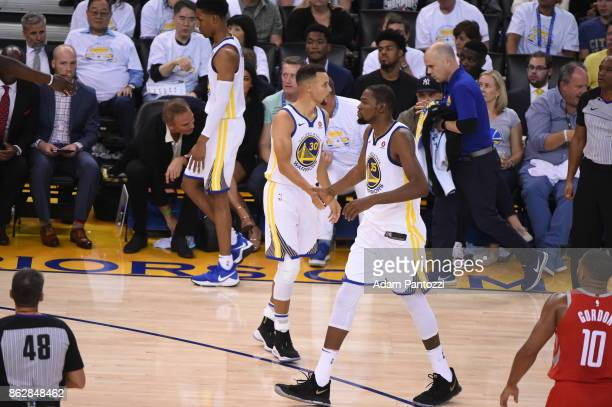 Kevin Durant of the Golden State Warriors and Stephen Curry during the game against the Houston Rockets on October 17 2017 at ORACLE Arena in Oakland...