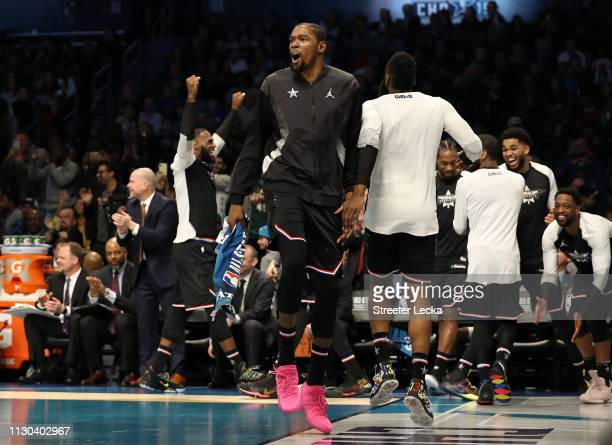 Kevin Durant of the Golden State Warriors and Team LeBron celebrates from the bench in the third quarter against Team Giannis during the NBA All-Star...