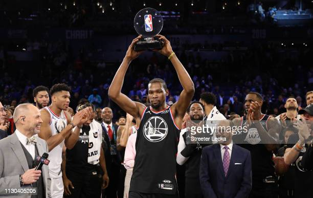 Kevin Durant of the Golden State Warriors and Team LeBron celebrates with the MVP trophy after their 178164 win over Team Giannis during the NBA...