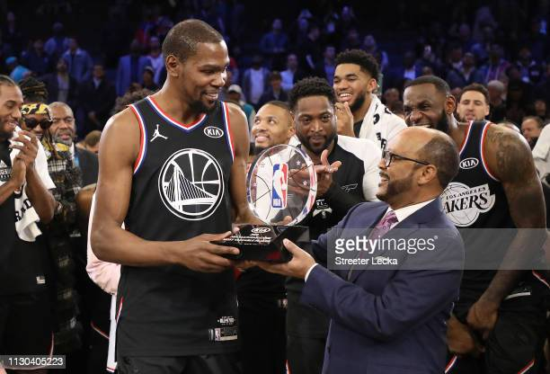 Kevin Durant of the Golden State Warriors and Team LeBron is awarded the MVP trophy after their 178164 win over Team Giannis during the NBA AllStar...