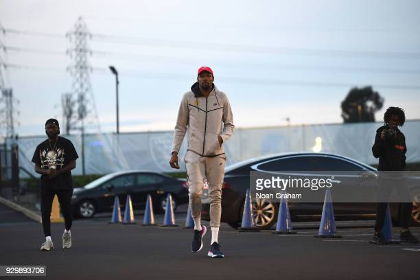 Kevin Durant of the Golden State Warriors arrives at the stadium before the game against the Brooklyn Nets on March 8 2018 at ORACLE Arena in Oakland...