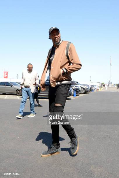Kevin Durant of the Golden State Warriors arrives to the arena before the game against the San Antonio Spurs during Game One of the Western...