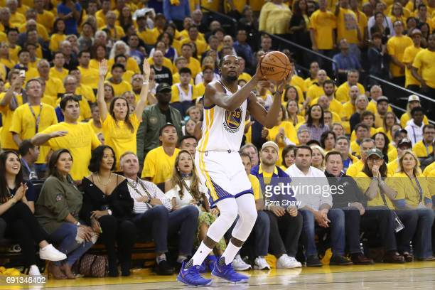 Kevin Durant of the Golden State Warriors attempts a jump shot against the Cleveland Cavaliers in Game 1 of the 2017 NBA Finals at ORACLE Arena on...