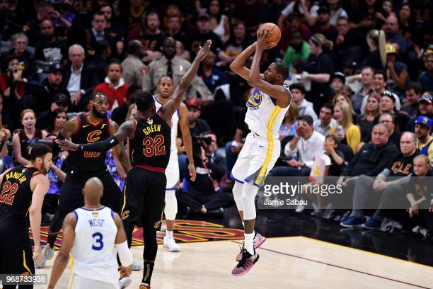 Kevin Durant of the Golden State Warriors attempts a jumper over Jeff Green of the Cleveland Cavaliers in the first half during Game Three of the...