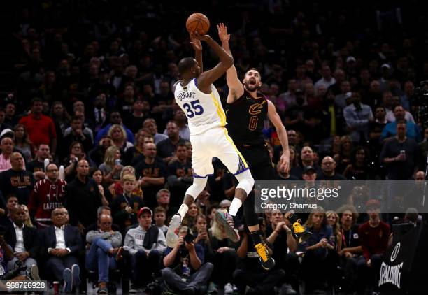 Kevin Durant of the Golden State Warriors attempts a jumper over Kevin Love of the Cleveland Cavaliers in the second half during Game Three of the...