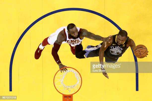 Kevin Durant of the Golden State Warriors attempts a layup against LeBron James of the Cleveland Cavaliers in Game 2 of the 2018 NBA Finals at ORACLE...