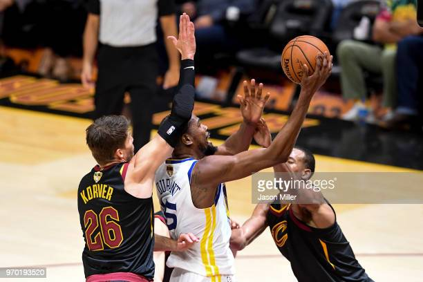 Kevin Durant of the Golden State Warriors attempts a layup defended by Rodney Hood and Kyle Korver of the Cleveland Cavaliers during Game Four of the...